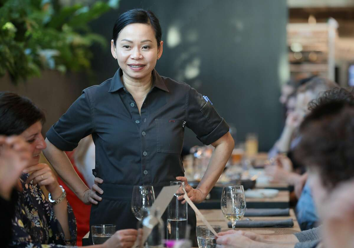 Pim Techamuanvivit talks with invited guests before she opens her second San Francisco restaurant Nari on Wednesday, Aug. 7, 2019 in San Francisco, Calif.
