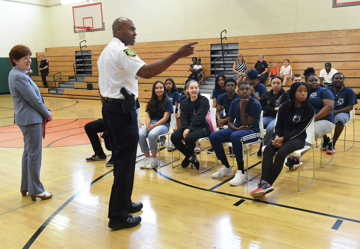 Albany Mayor Kathy Sheehan, left, and Albany Police Chief Eric Hawkins speak to the cadets during the Albany Police Department Cadet Graduation at Tony Clement Center for Education on Thursday, Aug. 8, 2019 in Albany, N.Y. The 16 cadets worked with the police department throughout the summer as part of the city's Summer Youth Employment Program. (Lori Van Buren/Times Union)