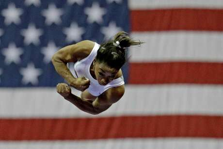 Simone Biles works on the vault during practice for the U.S. gymnastics championships.