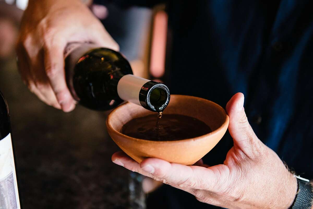 Wine director Jeff Berlin pours a wine into a piala, a traditional Georgian clay drinking bowl, at � C™tŽ restaurant in Oakland, Calif, on Wednesday, July 31, 2019.