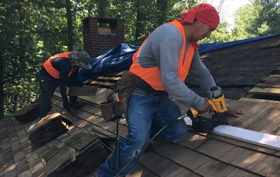 The new roof had to be made of cedar shakes because of the school's historic significance. Photo: Contributed Photo / Wilton Bulletin Contributed