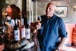 Wine director Jeff Berlin samples a traditional Georgian wine at � C™tŽ restaurant in Oakland, Calif, on Wednesday, July 31, 2019.