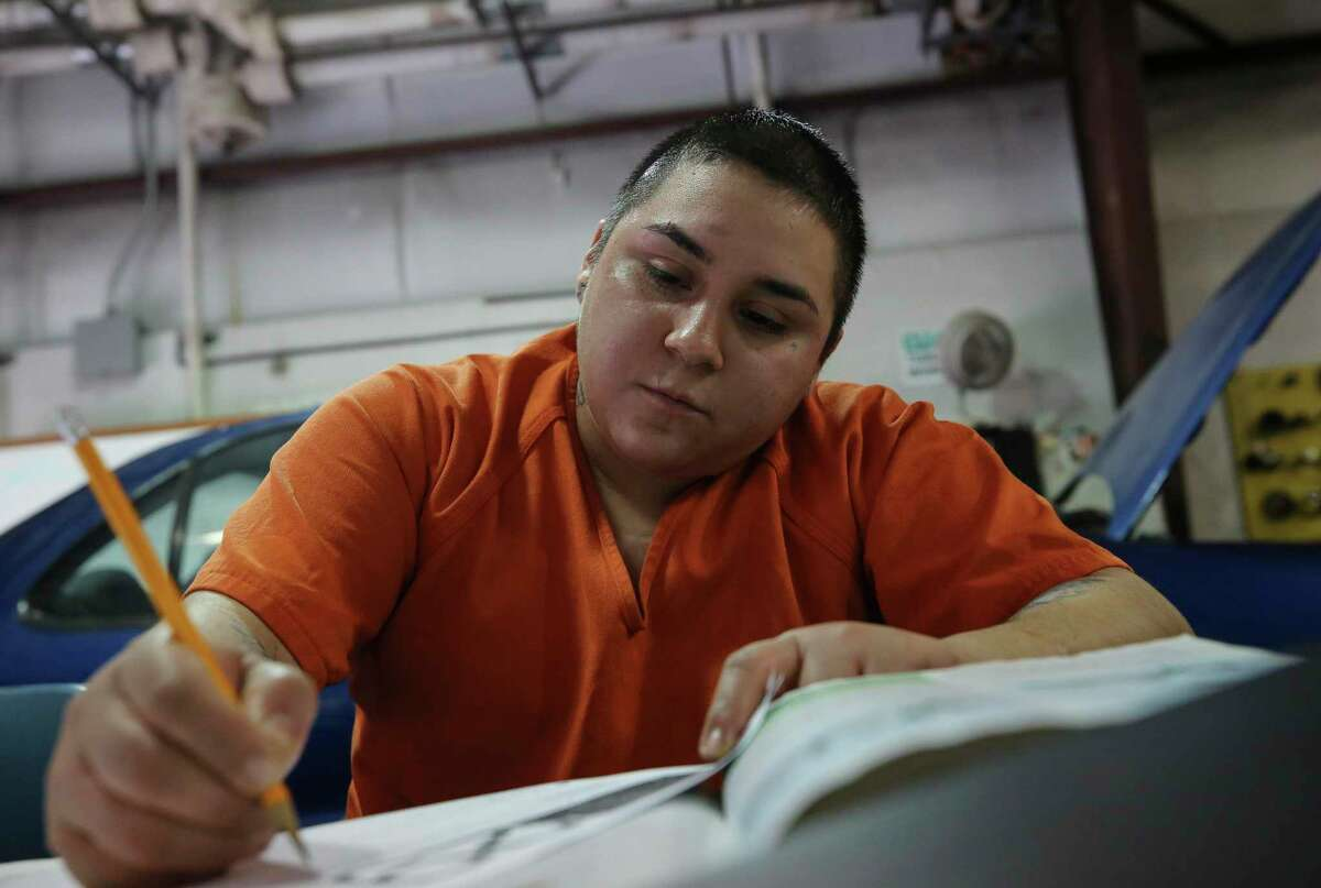 Gisella Ramirez, 23, completes a worksheet while attending the Harris County Jail's auto mechanics class Monday, July 22, 2019, in Houston. The jail's vocational programs for auto mechanics, and welding are being opened up to women for the first time.