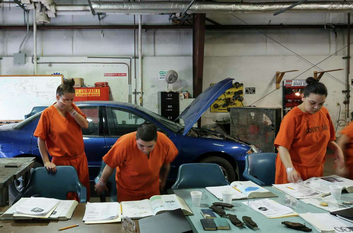Tasha Gates, Gisella Ramirez, and Tamara Ortiz (left to right) are part of the first auto mechanics class open for women Monday, July 22, 2019, in Houston.
