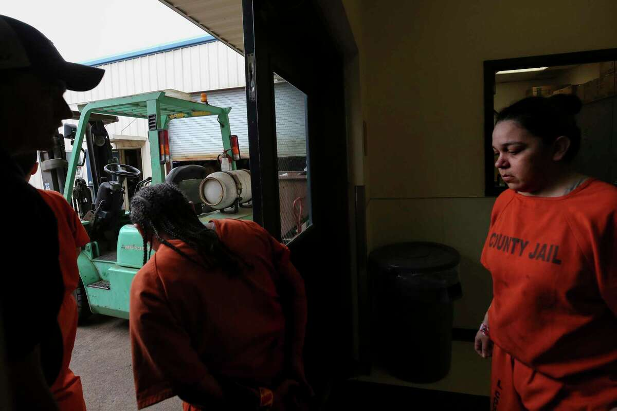 Harris County Jail inmates head to the auto mechanics classroom after eating breakfast Monday, July 22, 2019, in Houston. The jail's vocational programs for auto mechanics, and welding are being opened up to women for the first time.
