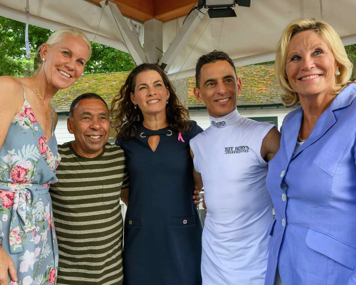 Aurora Games advisors Rennae Stubbs, left; Nancy Kerrigan, center and Donna de Varona, right are joined for a group photo by Hall of Fame jockeys Angel Cordero Jr;, second from left. and John , second from right, during their visit to the Saratoga Race Course on Fabulous Fillys Day Thursday Aug. 8, 2019 in Saratoga Springs, N.Y. Photo by Skip Dickstein