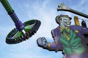 Six Flags Fiesta Texas has dozens of rides, including the Joker: Carnival of Chaos pendulum ride.