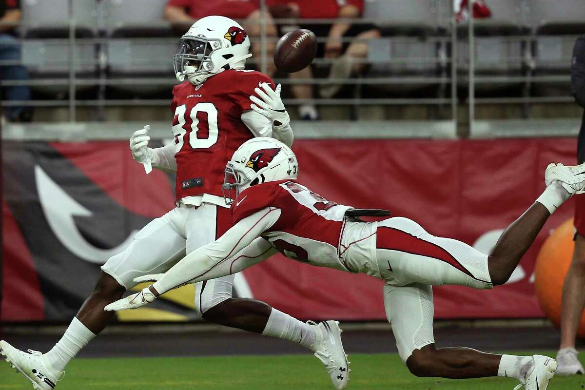 Arizona Cardinals safety Deionte Thompson, right, breaks up a pass intended for Cardinals wide receiver Isaac Zico (80) during an NFL football training camp practice at State Farm Stadium Tuesday, Aug. 6, 2019, in Glendale, Ariz. (AP Photo/Ross D. Franklin)
