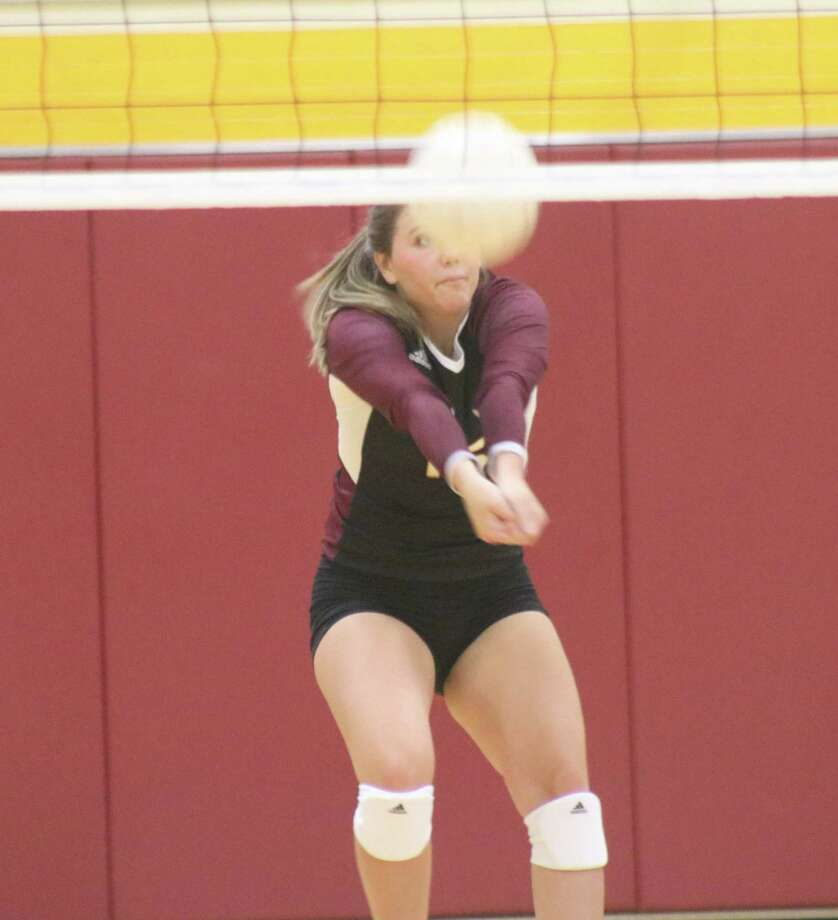 Kendall Nance serve-receives a ball during Wednesday's match with the Lady Knights. Photo: Robert Avery