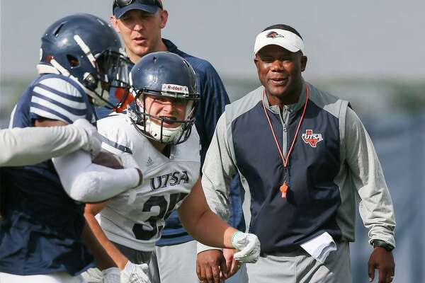 UTSA head football coach Frank Wilson, right, watches action on the field beside offensive coordinator Jeff Kastl during a practice session at the school on Wednesday, Aug. 7, 2019.