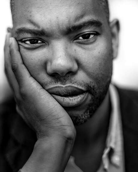 FILE - Ta-Nehisi Coates, the national correspondent for The Atlantic, in Baltimore, July 16, 2015. While Coates' works on being black in America have won great acclaim, he also has a not-so-secret identity as a Marvel Comics superfan, and has aged to helm a new series about Black Panther, the first black superhero, for the comics publisher. (Gabriella Demczuk/The New York Times)
