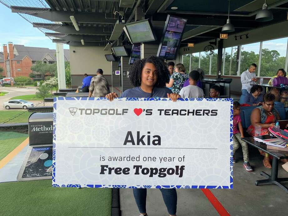 Akia Stewart, special education teacher for Cy-Fair ISD, was surprised with a free year of Topgolf. Photo: Topgolf