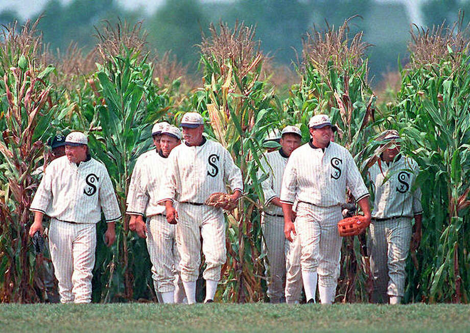 """Reenactors portraying ghost players emerge from a cornfield as they reenact a scene from the movie """"Field of Dreams"""" at the movie site in Dyersville, Iowa. The Chicago White Sox will play a game against the New York Yankees next August at the site in Iowa where the movie """"Field of Dreams"""" was filmed. Major League Baseball has announced that the White Sox will play host to the Yankees in at the site on Aug. 13 next year. Photo: AP File"""