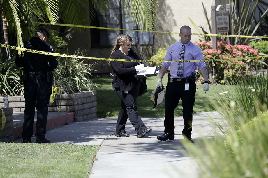 Investigators search the scene of a stabbing that killed two people in Garden Grove (Orange County). Police say Zachary Castaneda also killed two other people in a wave of violence. Photo: Marcio Jose Sanchez / Associated Press