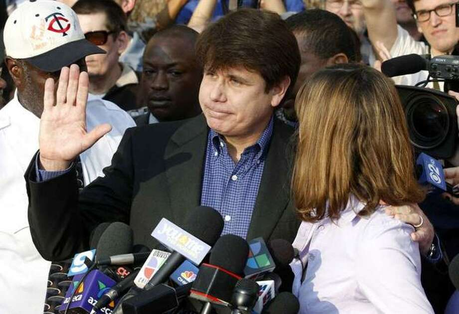 "In this March 14, 2012, file photo, former Illinois Gov. Rod Blagojevich, with his wife Patti at his side, speaks to the media in Chicago before reporting to federal prison in Denver. President Donald Trump says he's ""very strongly"" considering commuting the sentence of Blagojevich, who is serving a 14-year prison term on multiple federal corruption convictions. Trump suggested more than a year ago that he was considering a commutation for Blagojevich, who then filed paperwork requesting a commutation. Photo: M. Spencer Green, AP"