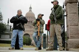 In this Jan. 13, 2015 file photo, gun rights advocates carry rifles while protesting outside the Texas Capitol in Austin, Texas. (AP Photo/Eric Gay, File)