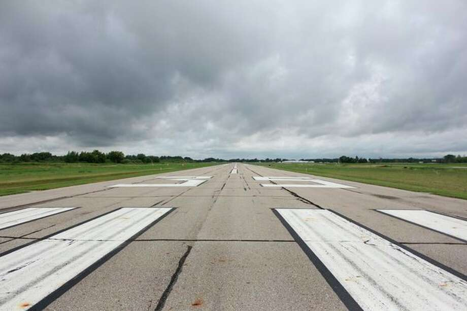The 5,009-foot long runway at the Huron County Memorial Airport in Bad Axe is scheduled to be repaved sometime next year. (Robert Creenan/Huron Daily Tribune)