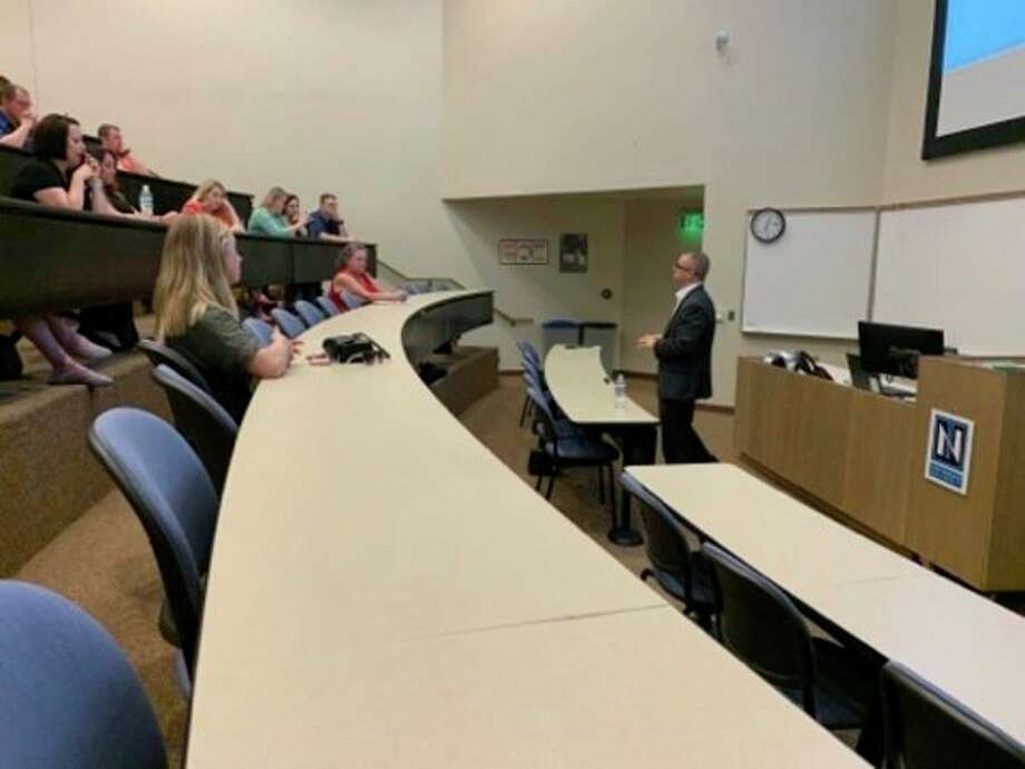 "Attorney Kevin Mulcahy gives his keynote speech ""Randy and Me: A Prosecutor's Story of His Childhood Sexual Abuse"" to a crowd of Midland residents on Aug. 7, 2019 in Northwood University's Sloan Family Building. (Mitchell Kukulka/Mitchell.Kukulka@mdn.net)"