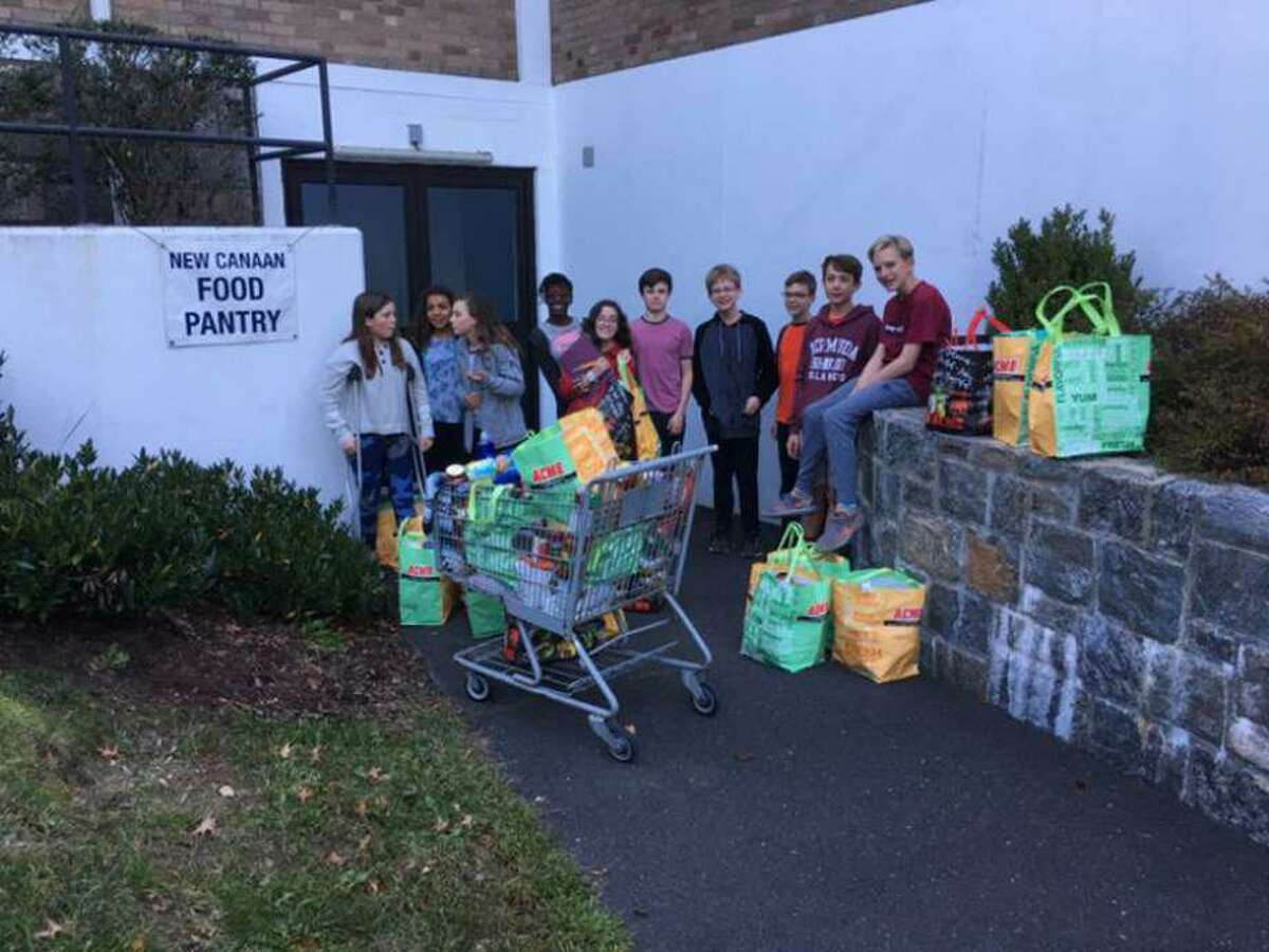 The New Canaan Food Pantry at St. Mark's Episcopal Church, which is located at 111 Oenoke Ridge in New Canaan, Connecticut being stocked, and also organized by students preparing the items from it for delivery to places in the community.
