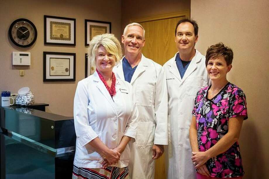 From left, Phlebotomist Shelley Goeckel, Dr. Blake Bergeon, Dr. John Szajenko and Phlebotomist Leslie Vedrode pose for a portrait inside Vitamindrip & Wellness of Midland at 555 W. Wackerly St. in Midland. (Katy Kildee/kkildee@mdn.net)