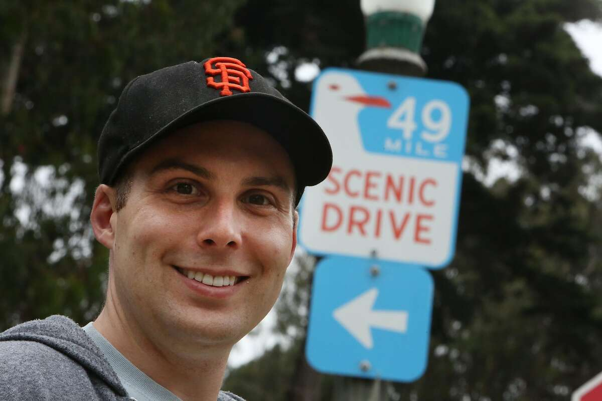 Eric Kingsbury stands for a portrait next to a 49 mile scenic drive sign on Monday, August 5, 2019 in San Francisco, Calif. Eric Kingsbury walked the entire 49 miles in one day in early July.