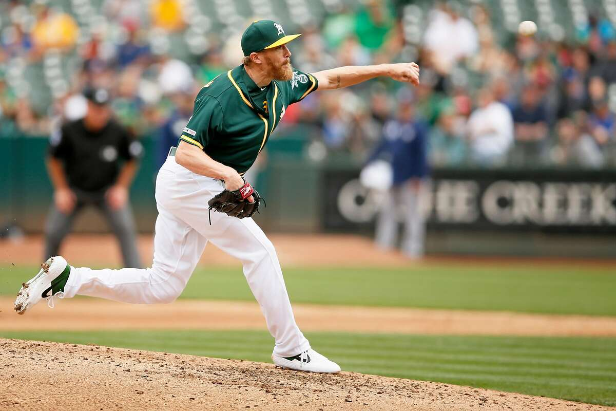 Oakland Athletics relief pitcher Jake Diekman (35) throws during the seventh inning of an MLB game against the Milwaukee Brewers at the Oakland-Alameda County Coliseum, Thursday, Aug. 1, 2019, in Oakland, Calif.