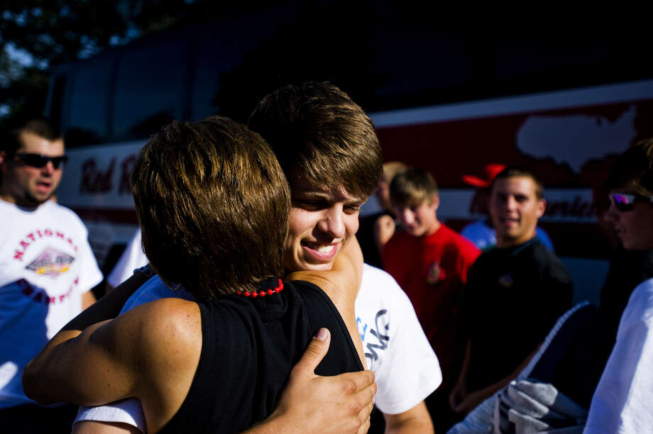 Berryhill's Kenny Babinski embraces mother Laurie Babinski after arriving home from the 2009 American Legion Baseball World Series in Fargo, N.D. Photo: Daily News File Photo