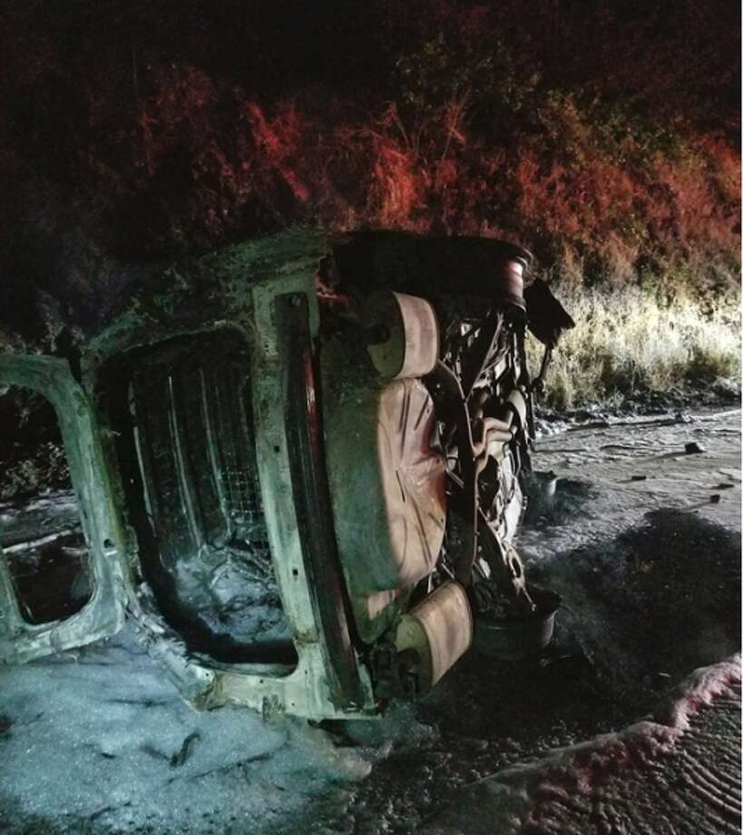 A Humboldt County sheriff's deputy's car is a charred shell after it caught fire Saturday, Aug. 3, 2019, on Highway 96 near Weitchpec. A bear that apparently fell off an embankment and landed on the vehicle is being blamed for the rollover crash, which sparked a small wildfire. Photo: Hoopa Fire And Office Of Emergency Services Fire Chief Rod Mendes