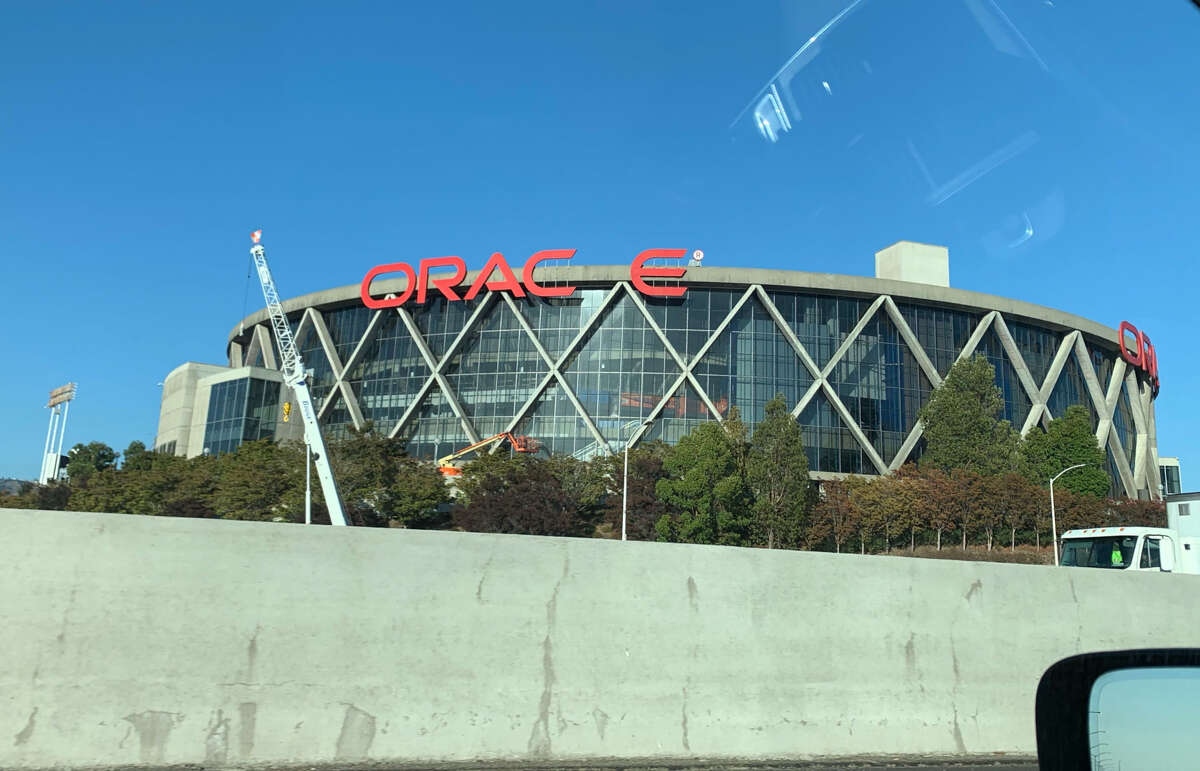 The letters of the Oracle Arena sign are being taken down as the Warriors officially move to Chase Center in San Francisco.