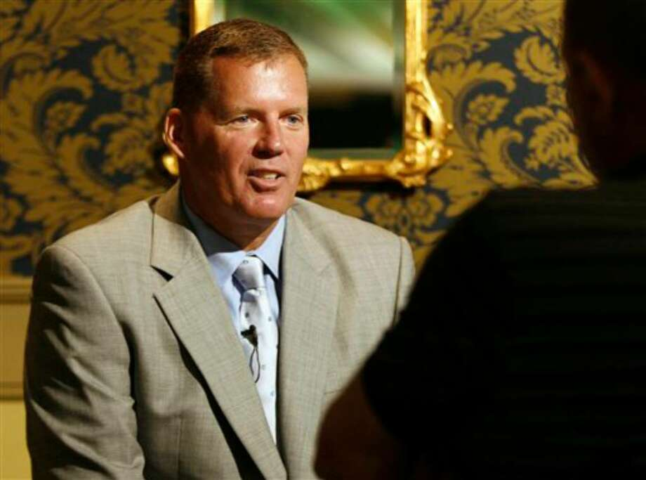 Connecticut head football coach Randy Edsall, left, answers questions during a television interview during the Big East Football media day, Tuesday, Aug. 3, 2010, in Newport, R.I.. (AP Photo/Stew Milne) Photo: Stew Milne, AP / FR56276 AP