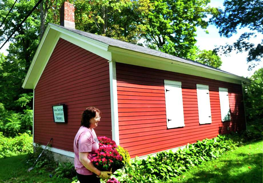 Karen Keeler of the New Fairfield Historical Society gets the Little Red Schoolhouse in New Fairfield, Conn., ready for the upcoming Octoberfest. She is gardening during the open house Sunday, Sept. 15, 2013. The Little Red Schoolhouse was used for grades 1 through 8 until 1941 and is open to the public the third Sunday of every month. Photo: Michael Duffy / Michael Duffy / The News-Times