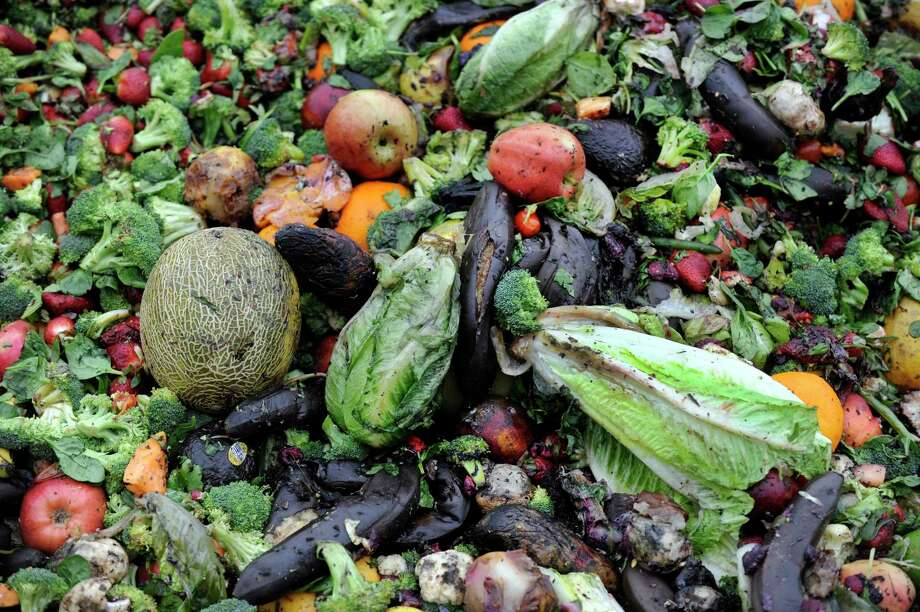 Fruits and vegetables sit in a compost pile. Photo: Hearst Connecticut Media File Photo / The News-Times