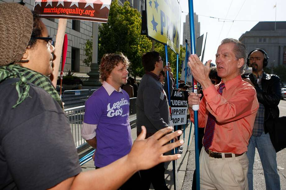 (Left to right) Sandra Barrera and Glendon Hyde argue with anti-same-sex marriage supporter Don Grundmann outside the California Supreme Court. Photo: Mike Kepka / The Chronicle