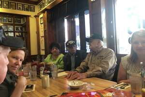 Holocaust survivors, liberators, family members and museum officials gather for lunch on Tuesday, Aug. 6, at Kenny & Ziggy's New York Delicatessen Restaurant on Post Oak. The Jewish deli is raising funds for the Holocaust Museum Houston during August through a special National Deli Month menu.