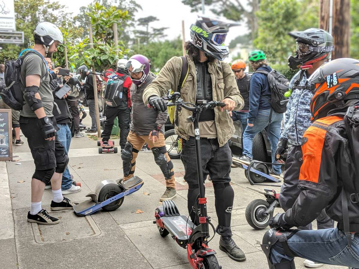 The Bay Area Esk8 squad gets ready to roll out after fueling up on burgers (and battery power) at Links Bar and Grill on August 3, 2019 in San Francisco.