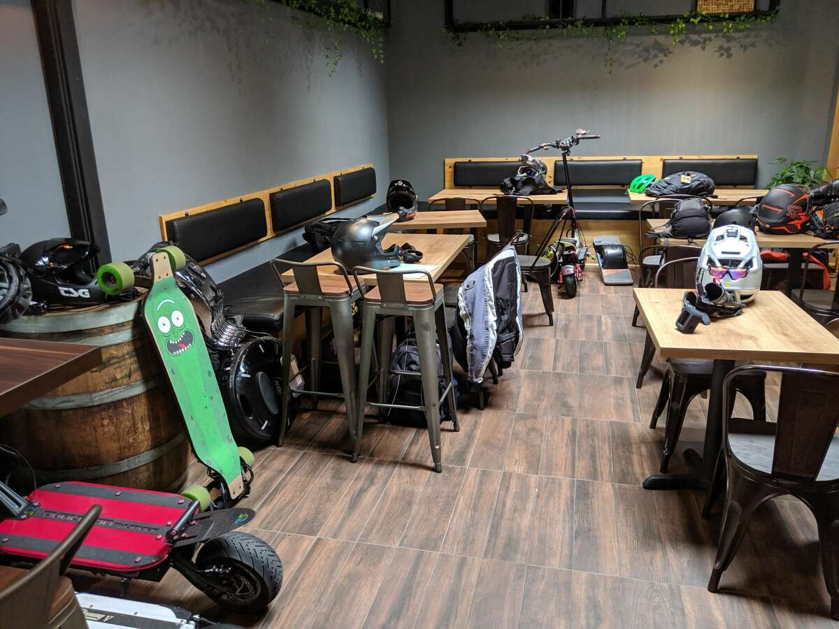 Halfway through their five hour group ride, the Bay Area Esk8 stop at Links Bar and Grill to charge their rides on August 3, 2019 in San Francisco.