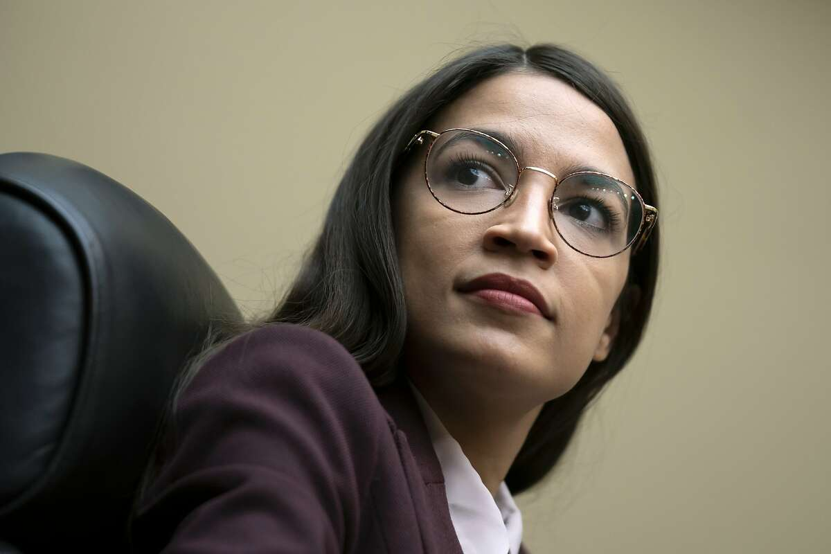 FILE - In this July 26, 2019 file photo, Rep. Alexandria Ocasio-Cortez, D-N.Y., attends a House Oversight Committee hearing on Capitol Hill in Washington. (AP Photo/J. Scott Applewhite)