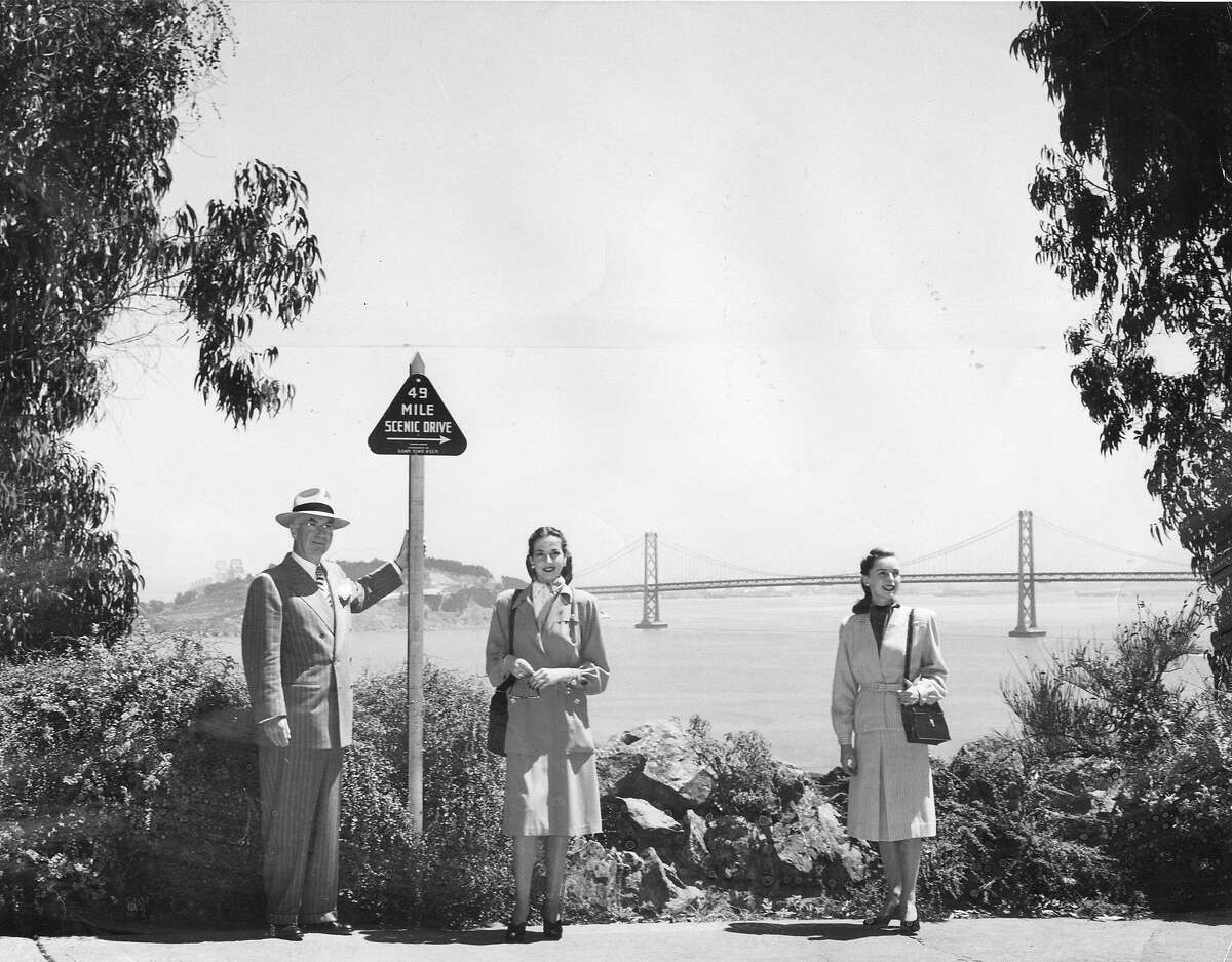Aug. 15, 1947: Members of the Down Town Business Association debut the new 49-Mile Scenic Drive signs in 1947. The Drive was suspended during World War II.