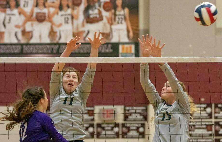 Lake Creek sophomore Anna Ertischek (11) and freshman Lauren Greene try to block a kill during the Katy/Cy-Fair Volleyball Classic on Thursday, August 8, 2019 at Cinco Ranch High School. Photo: Cody Bahn, Houston Chronicle / Staff Photographer / © 2019 Houston Chronicle