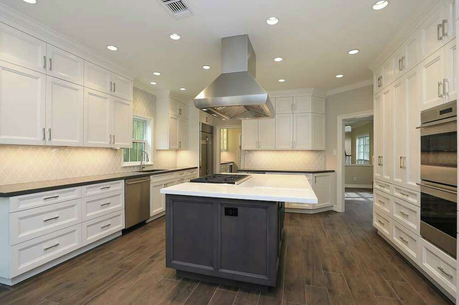 This remodeled kitchen features recessed LED lighting and under-cabinet LED strips.