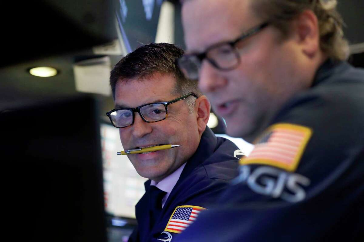 Specialist David Haubner, left, works on the floor of the New York Stock Exchange, Thursday, Aug. 8, 2019. Stock prices rose Thursday as investors braced for the next development in the U.S.-Chinese trade war, which has caused volatility in world markets this week, and after Beijing reported a rise in exports, easing some concerns about its economic slowdown. (AP Photo/Richard Drew)
