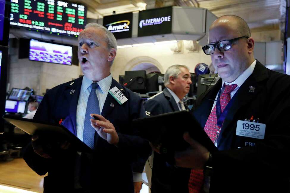 Traders James Riley, left, and Jeffrey Vazquez work on the floor of the New York Stock Exchange, Thursday, Aug. 8, 2019. Stock prices rose Thursday as investors braced for the next development in the U.S.-Chinese trade war, which has caused volatility in world markets this week, and after Beijing reported a rise in exports, easing some concerns about its economic slowdown. (AP Photo/Richard Drew)
