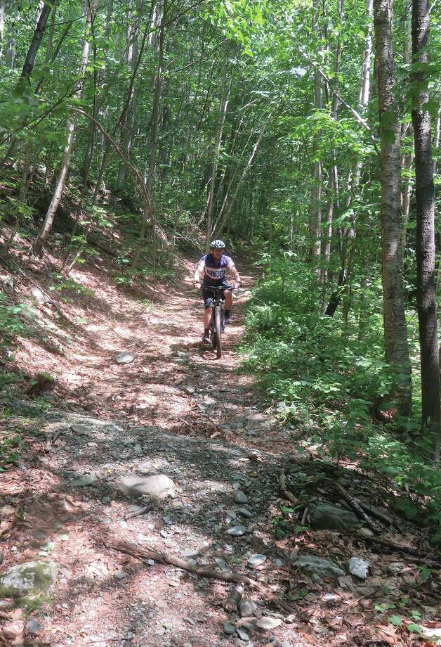 A rider considers his health care deductable as he descends Dorset Peak. (Herb Terns / Times Union) Photo: Herb Terns / Times Union