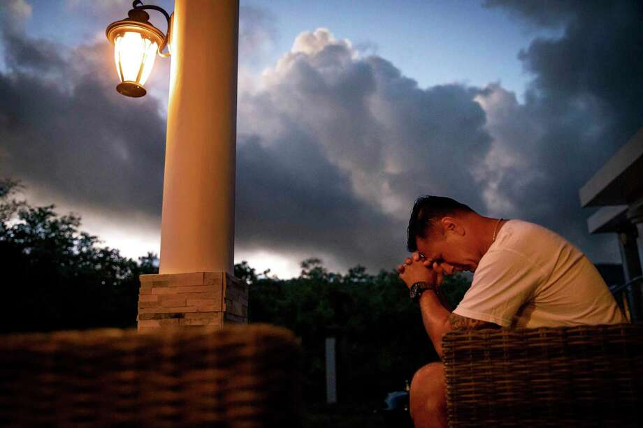 """Walter Denton prays as the sun rises in his backyard in Agat, Guam, Saturday, May 11, 2019. Denton is one of over 200 former altar boys, students and Boy Scouts who are now suing Guam's Catholic archdiocese over decades of sexual abuse they say they suffered at the hands of almost three dozen clergy, teachers and scoutmasters. """"He took everything from me. From that day forward my demeanor changed. I break down, I hurt everyday and I still hurt,"""" said Denton. But, he adds, """"he didn't ruin my faith. I still believe in God."""" Former Archbishop of Agana, Anthony Apuron denies the allegations. (AP Photo/David Goldman) Photo: David Goldman / 2019 Associated Press. All rights reserved."""