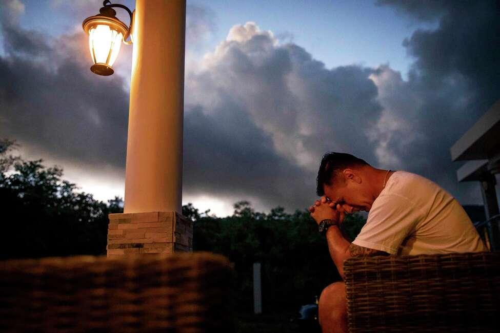 Walter Denton prays as the sun rises in his backyard in Agat, Guam, Saturday, May 11, 2019. Denton is one of over 200 former altar boys, students and Boy Scouts who are now suing Guam's Catholic archdiocese over decades of sexual abuse they say they suffered at the hands of almost three dozen clergy, teachers and scoutmasters.