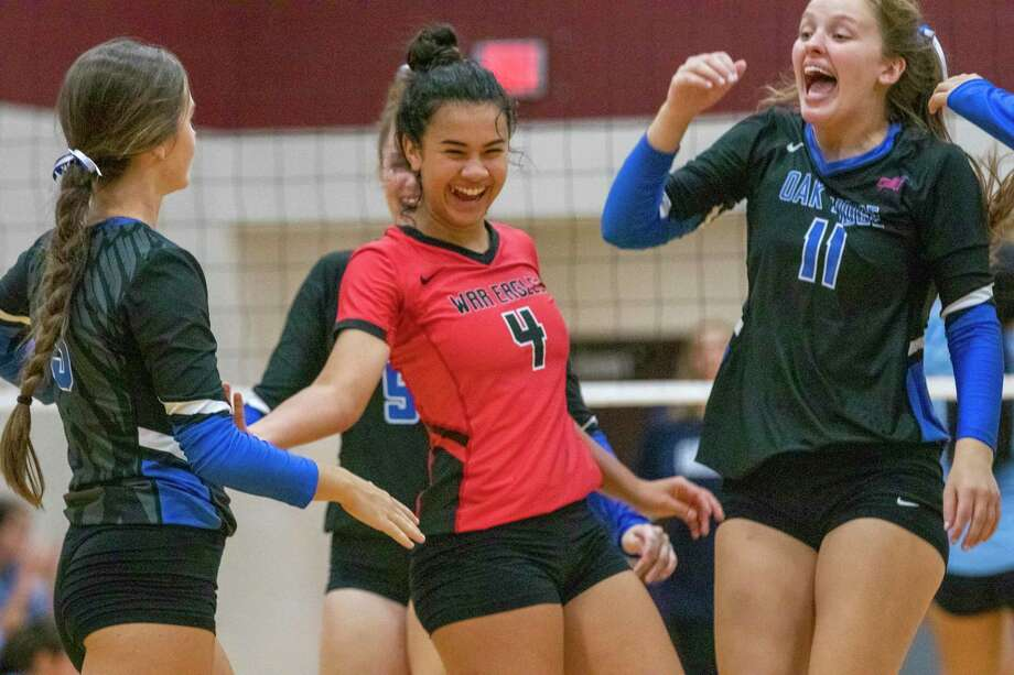 Oak Ridge celebrates after scoring during the Katy/Cy-Fair Volleyball Classic on Thursday, August 8, 2019 at Cinco Ranch High School. Photo: Cody Bahn, Houston Chronicle / Staff Photographer / © 2019 Houston Chronicle