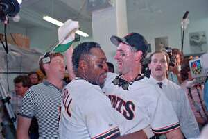 (Original Caption) San Francisco: Giants' Kevin Mitchell (L) and Will Clark celebrate National League Championship over Cubs.