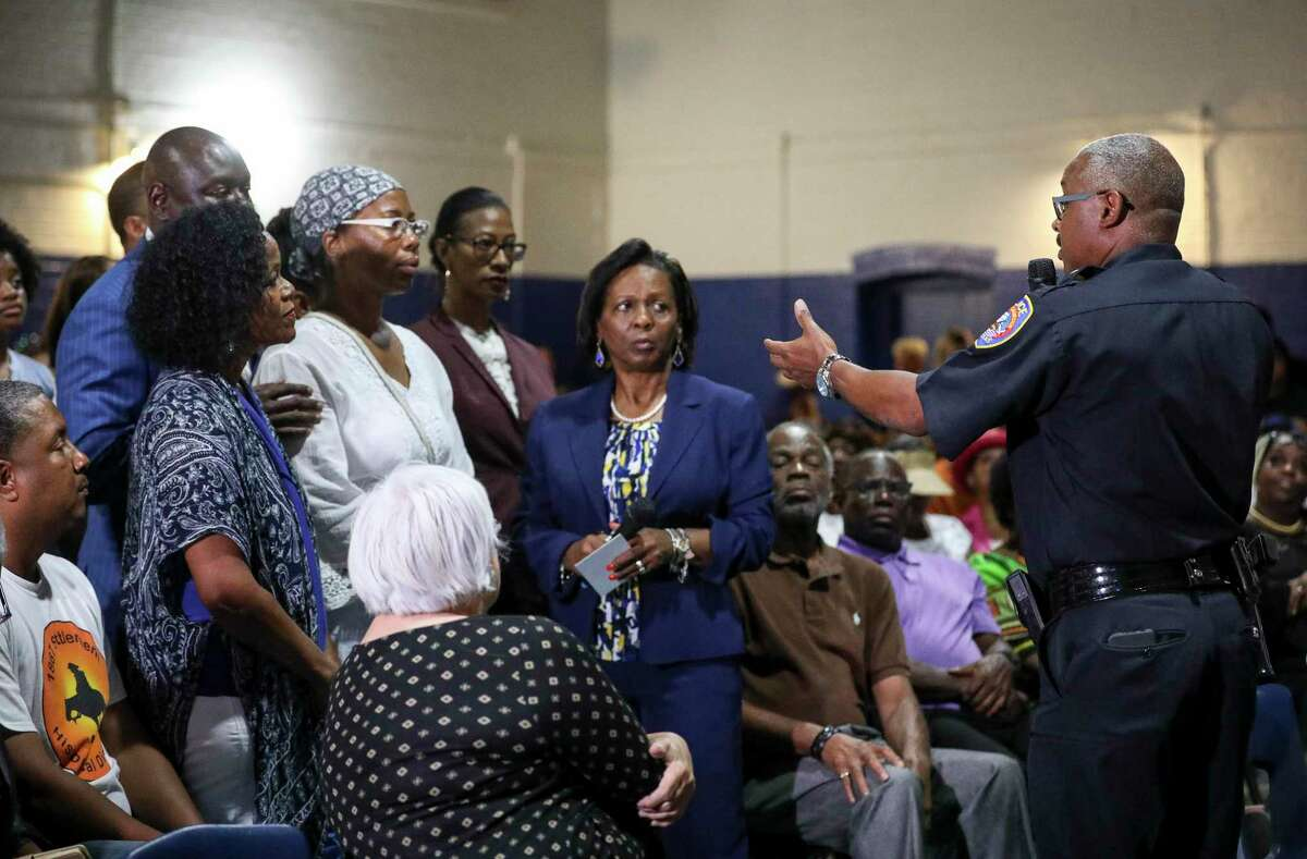 Galveston Police Chief Vernon Hale, right, speaks with family members of Donald Neely, their attorneys, and members of the public during a meeting about Neely's arrest, on Tuesday, Aug. 6, 2019, in Galveston. During the arrest, horse-mounted officers used what appeared to be a rope to lead Neely down the street.