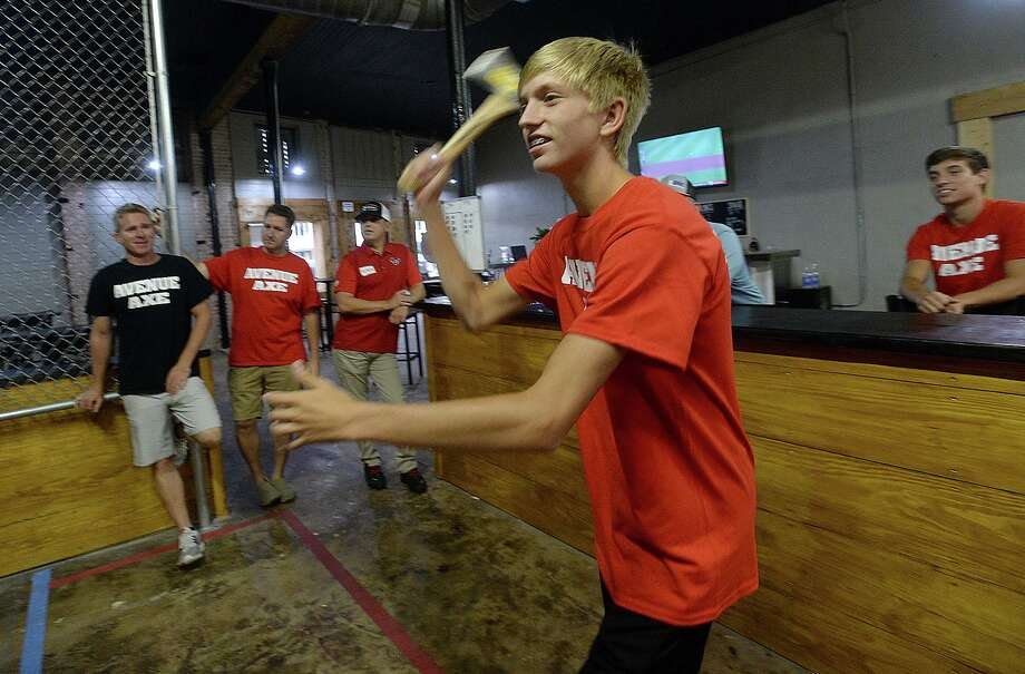 Austyn Meaux takes aim during a team competition at Avenue Axe in Port Neches. The establishment opened July 25 on Port Neches Avenue.   Photo taken Thursday, August 1, 2019 Kim Brent/The Enterprise Photo: Kim Brent / The Enterprise / BEN