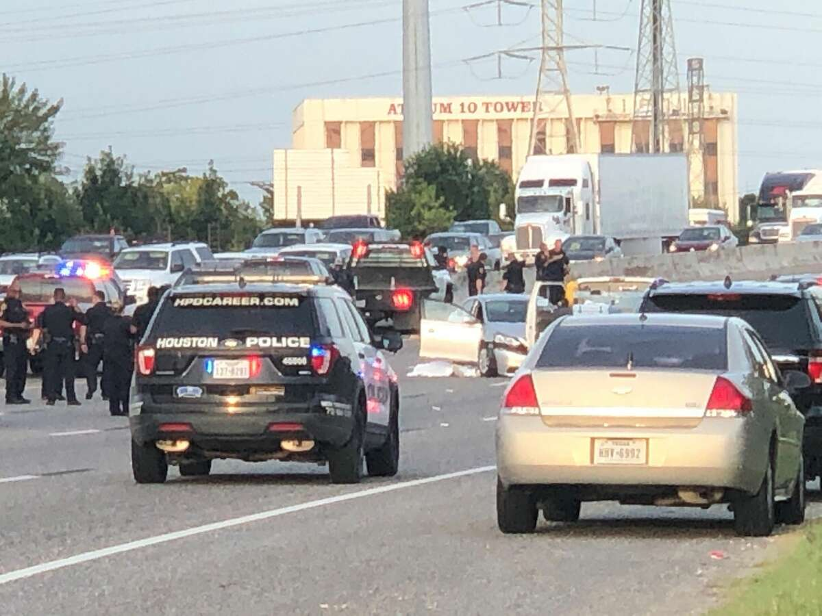 Houston Police investigate the scene on I-10 east near Mercury Dr, after two people were shot and killed on the freeway. The shooter is still on the loose, Thursday August 9, 2019, in Houston.